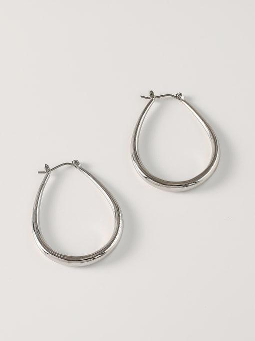 White K [small] Brass Hollow Geometric Minimalist Huggie Earring